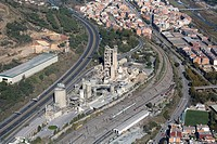 Spain, Catalonia, Barcelona, Barcelonés, Montcada, Lafarge cement plant, freeway C-33, town of Montcada in background