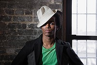Portrait of a young man wearing a fedora