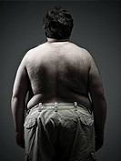 Rear view of overweight man