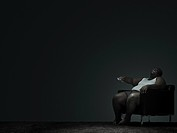 Overweight man watching television