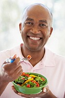 Middle Aged Man Eating Salad