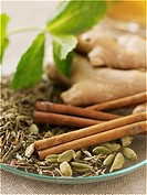 Ginger, cinnamon, cardamom and herbs to make tea