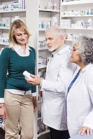 Pharmacists explaining medication to customer (thumbnail)