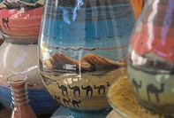 Close up of sand bottles with camels in landscapes, on souvenir stall, Jerash, Jordan, Middle East