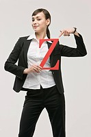 Business woman holding letter Z