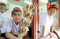 Eating a snack of skewers of scorpion at a hutong near Wang Fu Jing road, where grasshopper, sea horse, snakes, larva and starfish also served, Beijin...
