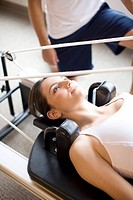 Close up of woman on pilates equipment