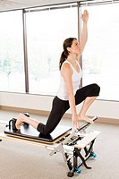 Woman working out on pilates equipment