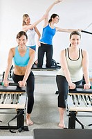 Portrait of smiling women on pilates equipment