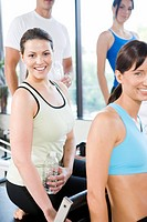 Portrait of smiling women in sportswear at gym