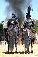 Two black knights from behind sit in their horses, in the background black cloud of smoke, knight festival Kaltenberger Ritterspiele, Kaltenberg, Uppe...