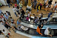 People on the escalator, shopping mall Centro, Oberhause, Ruhr Area, NRW, North Rhine_Westphalia, Germany
