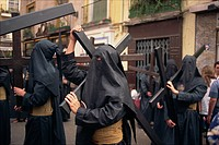Penitents bearing crosses in procession, Holy Week Semana Santa, Seville, Andalucia, Sapin, Europe