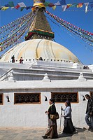 People walking round base of stupa, Lhosar Tibetan and Sherpa New Year festival, Bodhnath Buddhist stupa, UNESCO World Heritage Site, Kathmandu, Bagma...