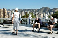 Two men read newspaper in a bench, balcony of the Mediterranean, Benidorm, Costa Blanca, Spain