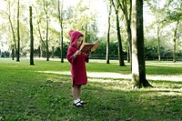 5 years old girl holding a book