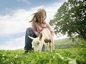 Girl Holding Goat
