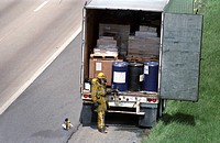 Firefighters examine hazardous cargo in the back of a tractor trailer on I95 in Beltsville, Md