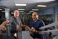 Portrait of senior men working out at gym, looking at camera