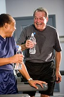 Portrait of multi_ethnic senior men drinking water at health gym