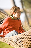 Portrait of young boy in hammock, looking at something interesting