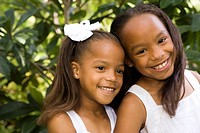 Outdoor portrait of happy African American girls, close_up