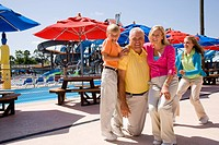 Family having fun near picnic area at water park