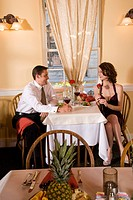 Couple enjoying romantic dinner in a fine restaurant