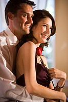 Portrait of attractive well_dressed couple in affectionate embrace in restaurant