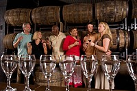 Couples on winery tour and wine tasting