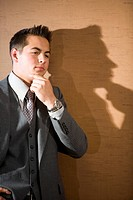 Profile of young businessman thinking