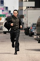 Business man running in street