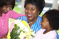 Surprised grandmother gets bouquet