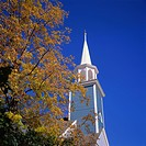 Trees in fall colours and wooden church spire at Wiscasset, Maine, New England, United States of America, North America