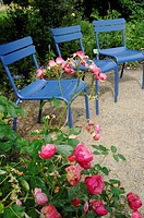 three blue garden chairs