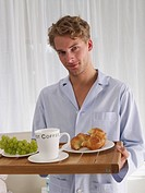 young man with breakfast