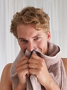 young man with towel