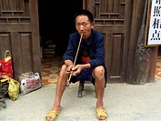 Man smoking, Yangtze River basin, China