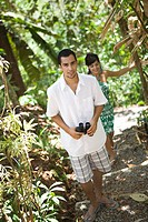 Couple walking through tropical forest