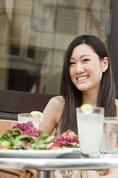 Woman smiling at outdoor restaurant