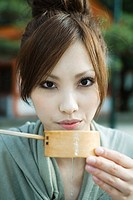 Woman drinking from traditional Japanese Hishaku ladle