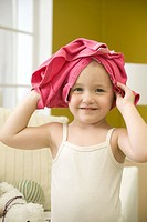 Toddler girl with shirt on head, portrait