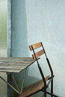 Folding chair leaning against table