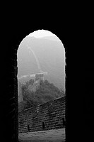 Looking out from arched doorway of room perched atop Great Wall of China (thumbnail)
