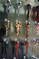 Rows of painted sample keys hanging on locksmith's rack