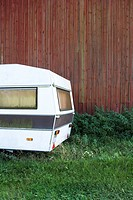 Abandoned camper in field, cropped