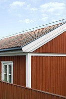 House with metal rod on roof, close-up, cropped