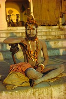 Hindu holy man, Ghatia meditating as the sun rises in the early morning, Varanasi Benares, Uttar Pradesh State, India