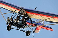 Ultralight aircraft coming in for landing, Camarillo, California, USA