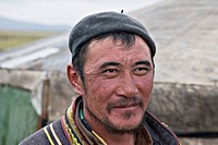 Mongolian herder ouside his residence, which is a tent known as a ger, north-central Mongolia No release available